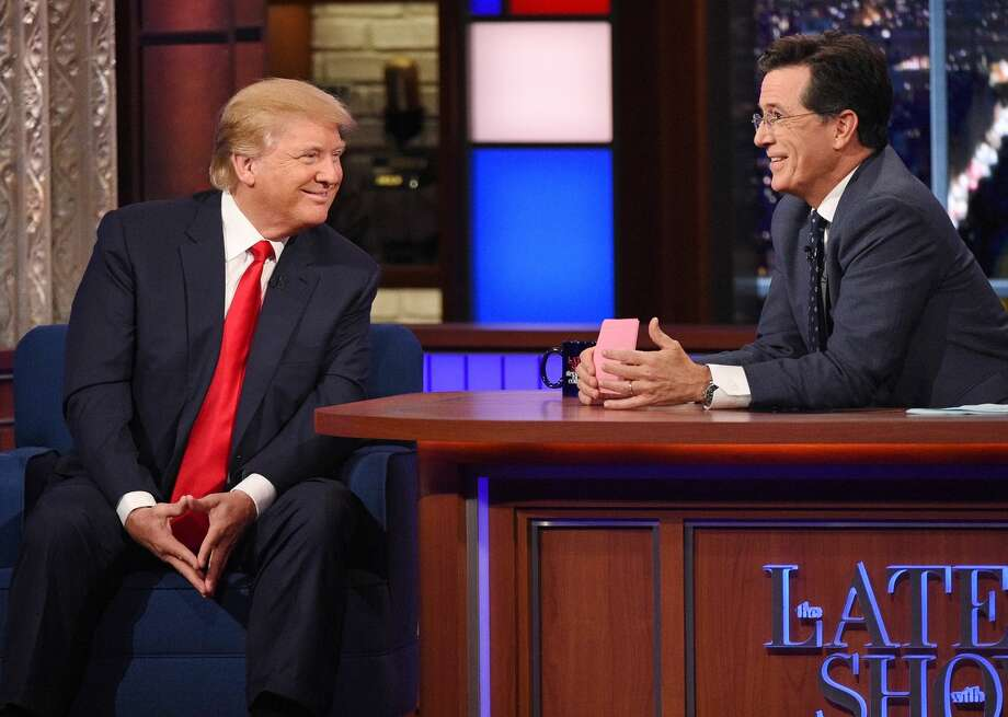 In this photo provided by CBS, Republican presidential candidate Donald Trump, left, joins host Stephen Colbert on the set of ìThe Late Show with Stephen Colbert,î Tuesday, Sept. 22, 2015, in New York. Photo: John Paul Filo/CBS Via AP    / CBS