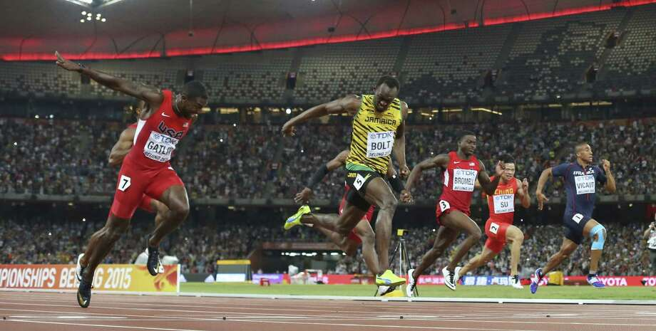 Jamaica's Usain Bolt crosses the finish line to win the men's 100 meter final at the World Athletics Championships in Beijing on Sunday. Photo: David J. Phillip — The Associated Press   / AP
