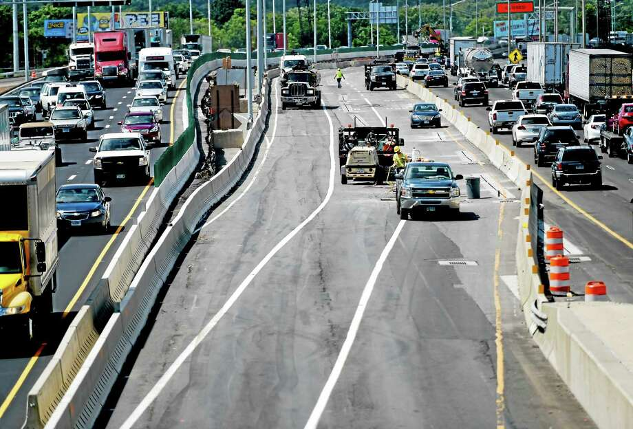 Southbound traffic on Interstate 95 over the West River bridge, right, will be shifted into the former northbound lanes, center, next weekend as part of the project to replace the bridge. Northbound traffic, shown at left, has been shifted to the new bridge. This view is taken from Howard Avenue, looking west. Photo: Peter Hvizdak — New Haven Register   / ©2015 Peter Hvizdak