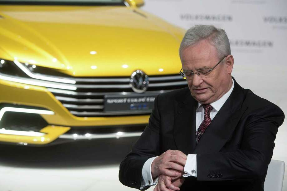 In this March 12, 2015 picture Volkswagen CEO, Martin Winterkorn, looks at his watch.  during the anual press conference of Volkswagen AG in Berlin. Volkswagen CEO Martin Winterkorn said Wednesday, Sept. 23, 2015 he is stepping down. Photo: Jochen Luebke/dpa Via AP   / dpa