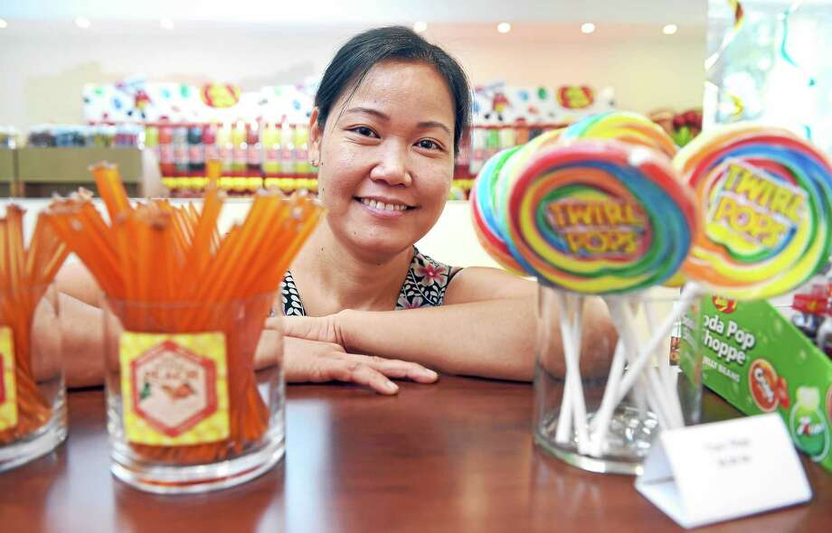 Kim Tran, owner of Canditopia, behind the counter of the recently opened candy store on Chapel Street in New Haven. Photo: Arnold Gold — New Haven Register