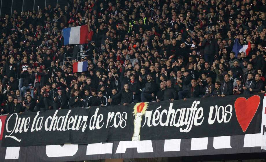 Supporters observed a minute's silence in memory of the victims of the last Paris Friday's attacks at the Nice Stadium before the French League One soccer match between Nice and Lyon on Friday. Photo: AP Photo   / AP