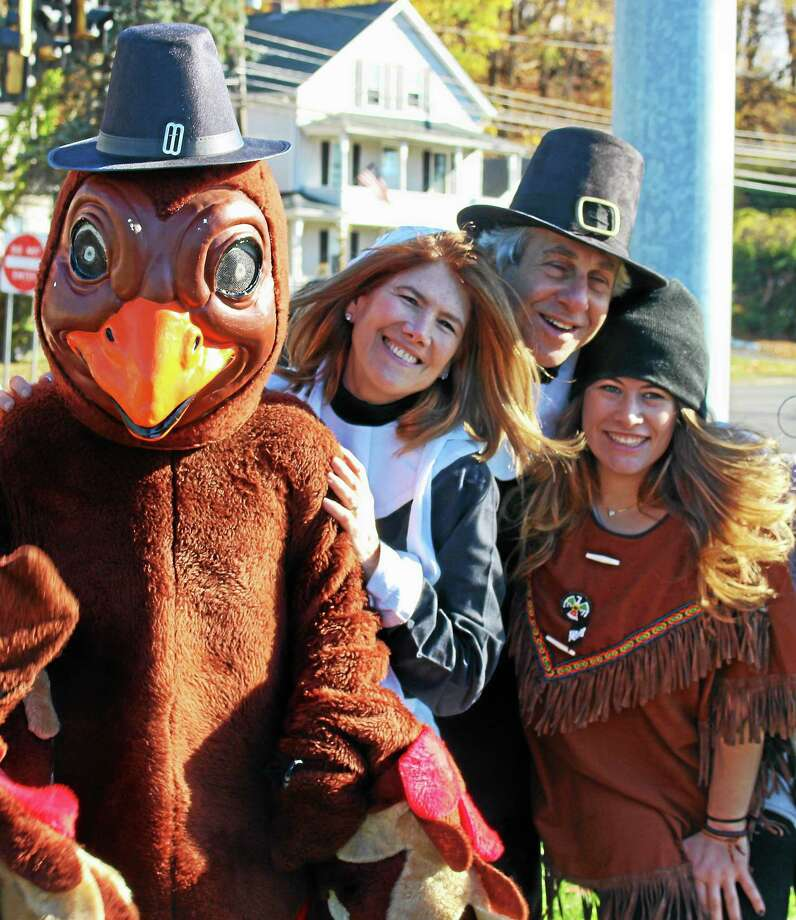 From left, Kate Pipa, dressed as a turkey, is seen with Bruce Sofferman, Deborah Sofferman, and Sophia Sofferman at the Soffermans' annual food drive Friday. Photo: JEAN FALBO-SOSNOVICH — NEW HAVEN REGISTER