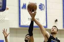 Dallas Mavericks' Christian Wood (25) and Orlando Magic's Matt Costello (40) battle for a rebound during the second half of an NBA summer league basketball game, Monday, July 3, 2017, in Orlando, Fla. (AP Photo/John Raoux)