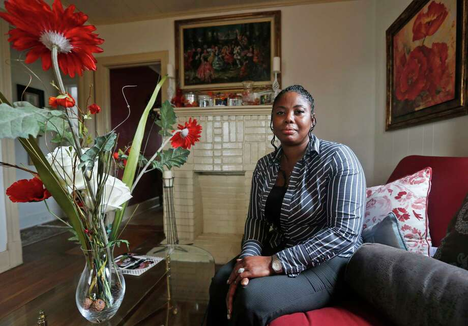 """Gwendolyn Smalls poses in her home in Richmond, Va., Nov. 12. Smalls' brother, Linwood R. Lambert Jr., died in police custody in May 2013 after being repeatedly stunned by South Boston police. Lambert's family filed a $25 million lawsuit in April, accusing the officers of unlawfully arresting him and using """"excessive, unreasonable and deadly force,"""" but no charges have been filed. Photo: Steve Helber — The Associated Press   / AP"""