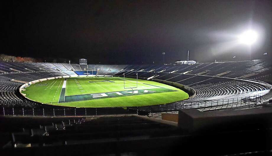 Lights are tested at Yale Bowl for Saturday's game against Harvard. The clash with the Crimson will mark the first time the Bulldogs have used lights for a home football game. Photo: Catherine Avalone — Register   / New Haven RegisterThe Middletown Press