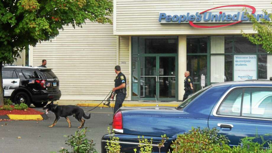Hamden police investigated a bank robbery Tuesday morning at the People's United Bank branch on Whitney Avenue near the Quinnipiac University campus. The suspect reportedly fled the bank northbound toward Cheshire. Photo: Wes Duplantier -- New Haven Register