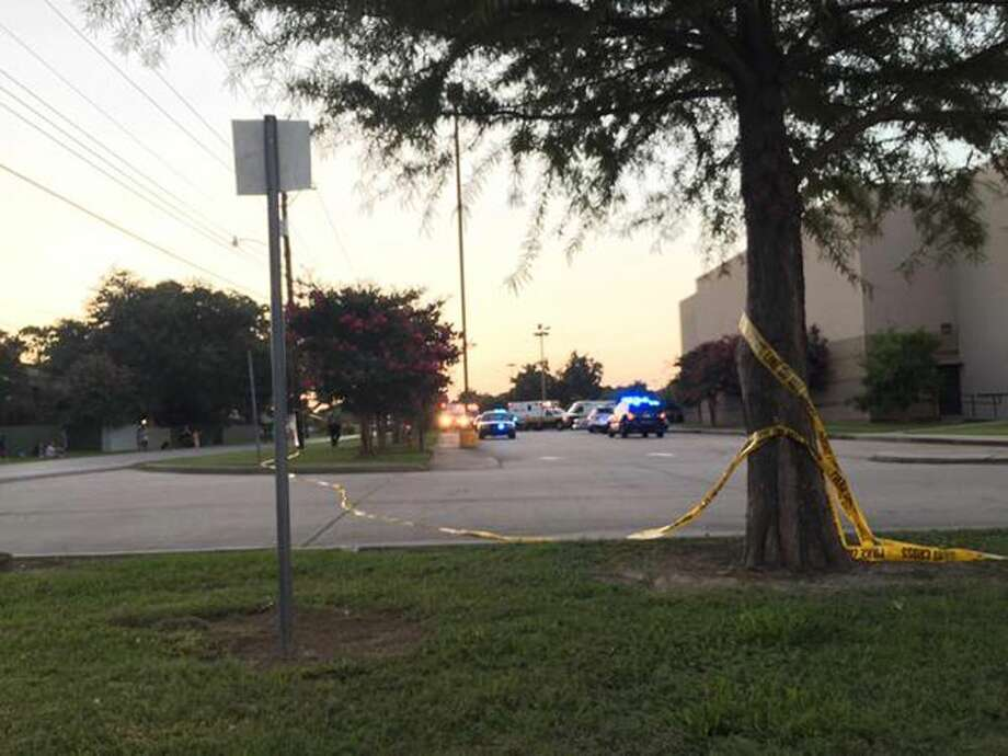 Police tape surrounds the scene following a shooting at a movie theater Thursday in Lafayette, La. Photo: Treylan Arceneaux Via AP / Treylan Arceneaux