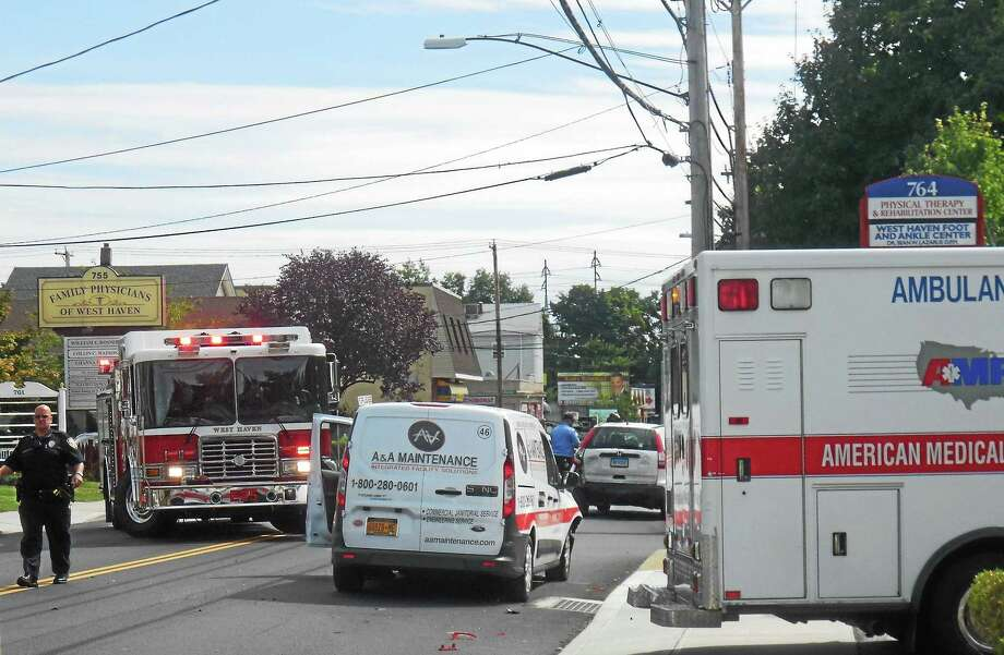 At least two vehicles were involved in a crash at the intersection of Campbell Avenue and Richards Street in West Haven early Tuesday afternoon. The crash was one of two accidents that briefly shut down Campbell Avenue in the area. Photo: Wes Duplantier -- New Haven Register