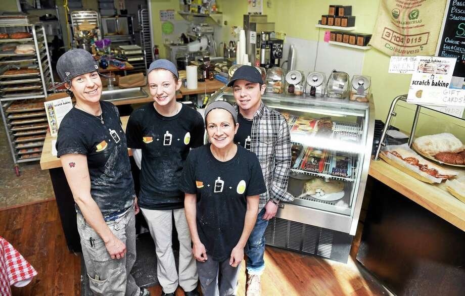 Lesli Flick (front), owner/baker at Scratch Baking, is photographed with her staff, (left to right) Kate Donato, head baker, Crystal Bransfield, baker, and general manager Alex Malaspinas, in Milford.. Photo: (Arnold Gold-New Haven Register)