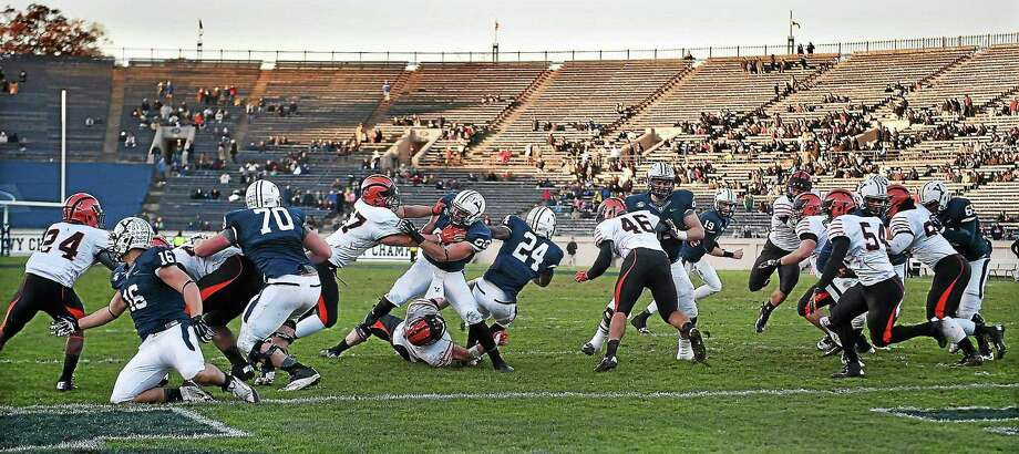 CATHERINE AVALONE — NEW HAVEN REGISTER FILE PHOTO  Yale and Princeton battle on the grass at Yale Bowl. Photo: Journal Register Co. / New Haven RegisterThe Middletown Press