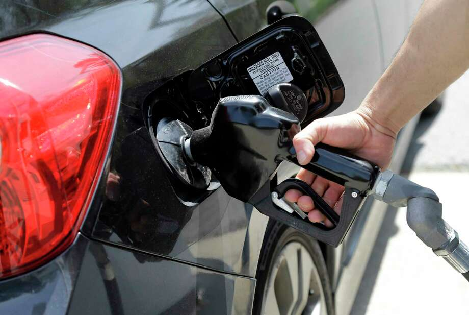 ASSOCIATED PRESS  In this May 8, 2015, file photo, gas station attendant Carlos Macar pumps gas in Andover, Mass. Photo: AP / AP