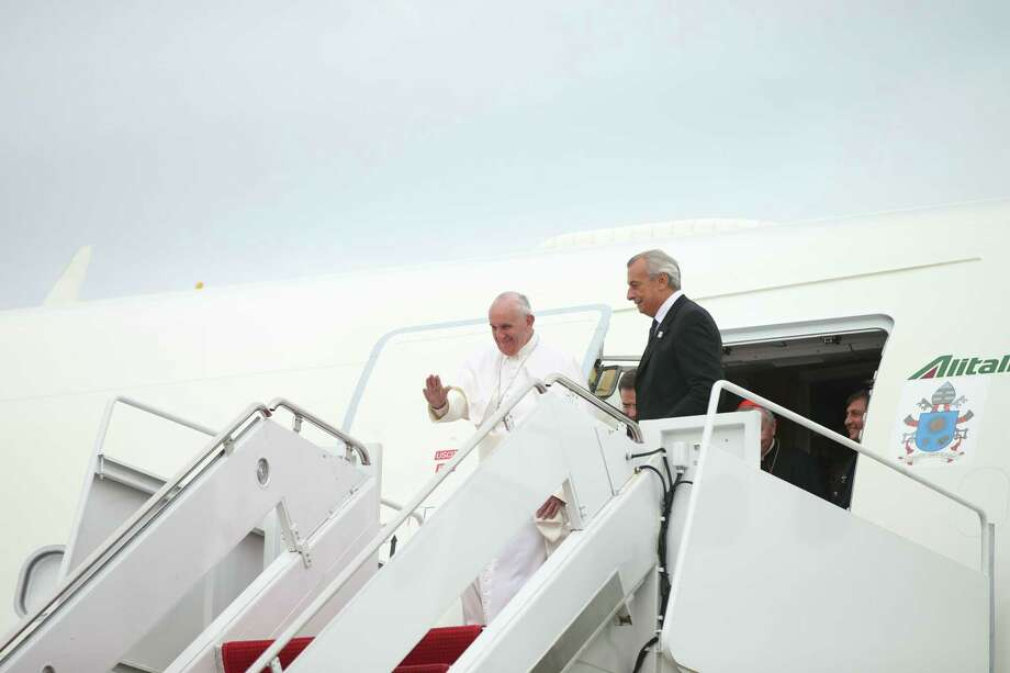 Pope Francis waves upon his arrival at Andrews Air Force Base, Md., Tuesday, Sept. 22, 2015, where President, Mrs. Obama, and others were to greet him. Photo: (AP Photo/Andrew Harnik)  / AP