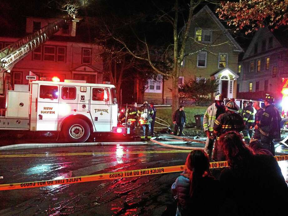 Firefighters at a two-alarm blaze at vacant 144 Goffe Terrace. Photo: Ryan Flynn/New Haven Register