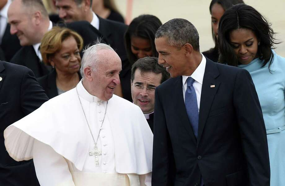 Pope Francis talks with President Barack Obama after arriving at Andrews Air Force Base in Maryland on Tuesday. Photo: (AP Photo/Susan Walsh) / AP