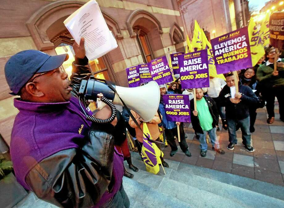 (Peter Hvizdak - New Haven Register)  Alberto Bernardez, assistant supervisor of SEIU Local 32BJ, leads a rally Monday in front of New Haven City Hall demanding a new contact with a wage increase. Photo: ©2015 Peter Hvizdak / ©2015 Peter Hvizdak