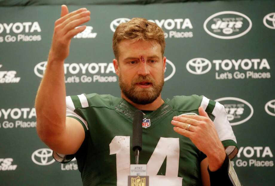 Jets quarterback Ryan Fitzpatrick responds to questions following Saturday night's win over the Cowboys. Photo: Michael Ainsworth — The Associated Press   / FR171389 AP