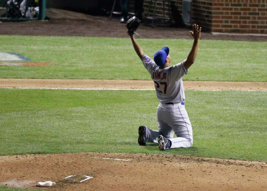 Mets pitcher Jeurys Familia celebrates after winning Game 4 of the National League Championship Series. The Mets won 8-3 to advance to the World Series. Photo: David Goldman  — The Associated Press   / AP