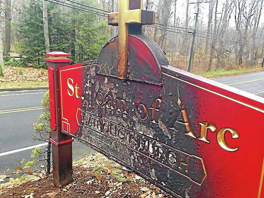 The St. Joan of Arc Church sign suffered fire damage after a small electrical fire caused by a motor vehicle accident Wednesday. Photo: (Kate Ramunni - New Haven Register)
