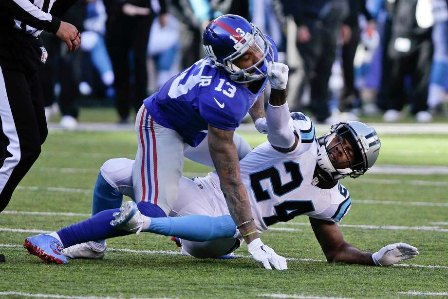 Giants wide receiver Odell Beckham (13) and Panthers cornerback Josh Norman get into it in the first half on Sunday. Photo: Julie Jacobson — The Associated Press   / AP
