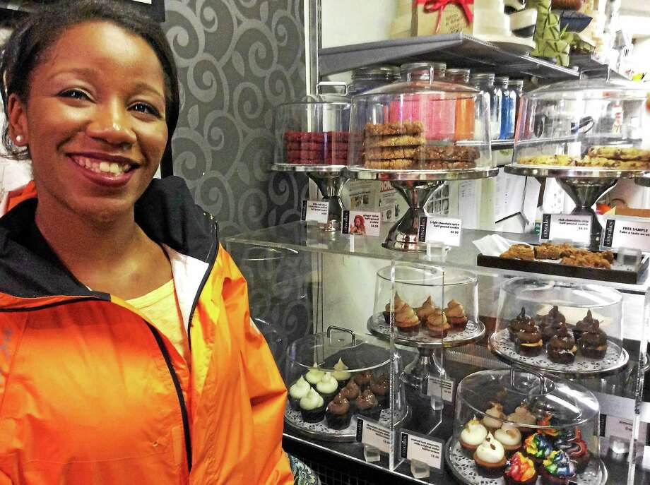 Sugartooth co-owner and tour guide Allyson Tolbert at a favorite tour stop, City Cakes, 251 W. 18th St. in New York City. Photo: Photos By Stephen Fries