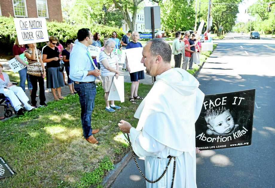The Rev. Benedict Croell of Washington, D.C., leads prayer during a protest in front of Planned Parenthood on Whitney Avenue in New Haven Saturday. Photo: Arnold Gold — New Haven Register