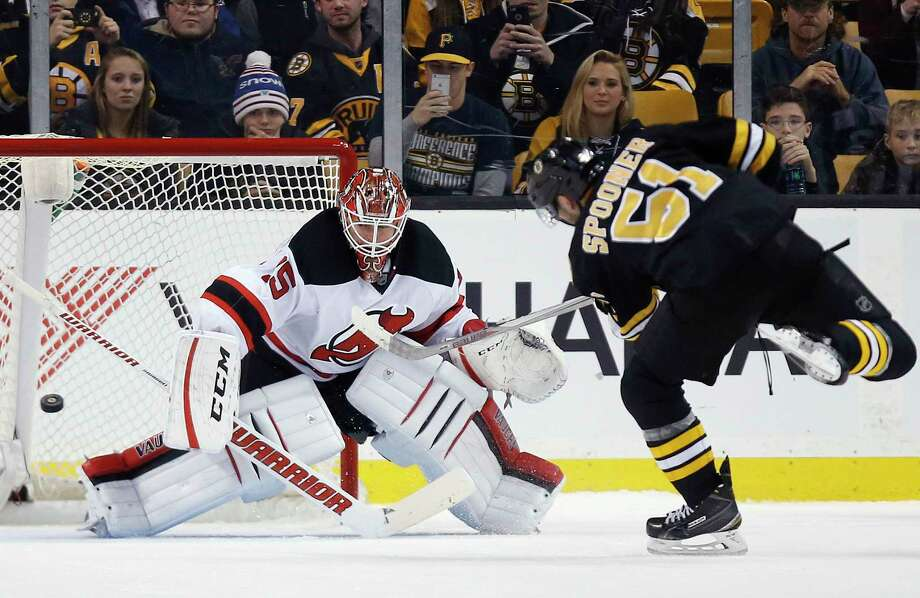 The Bruins' Ryan Spooner (51) scores on the Devils' Cory Schneider in a shootout during Sunday's game in Boston. Photo: Michael Dwyer — The Associated Press   / AP