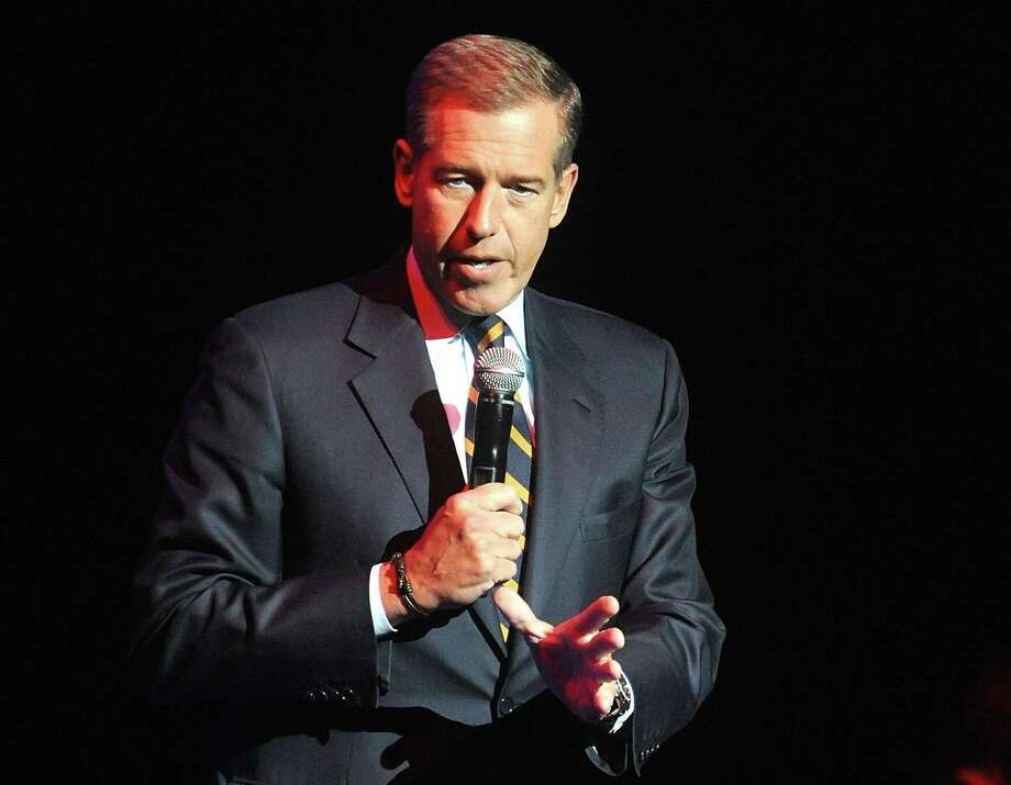 In this Nov. 5, 2014, file photo, Brian Williams speaks at the 8th Annual Stand Up For Heroes, presented by New York Comedy Festival and The Bob Woodruff Foundation in New York. Williams will return to the air  on Sept 22, 2015, as part of MSNBCís coverage of Pope Francisí visit to the United States. Photo: Photo By Brad Barket/Invision/AP, File    / Invision