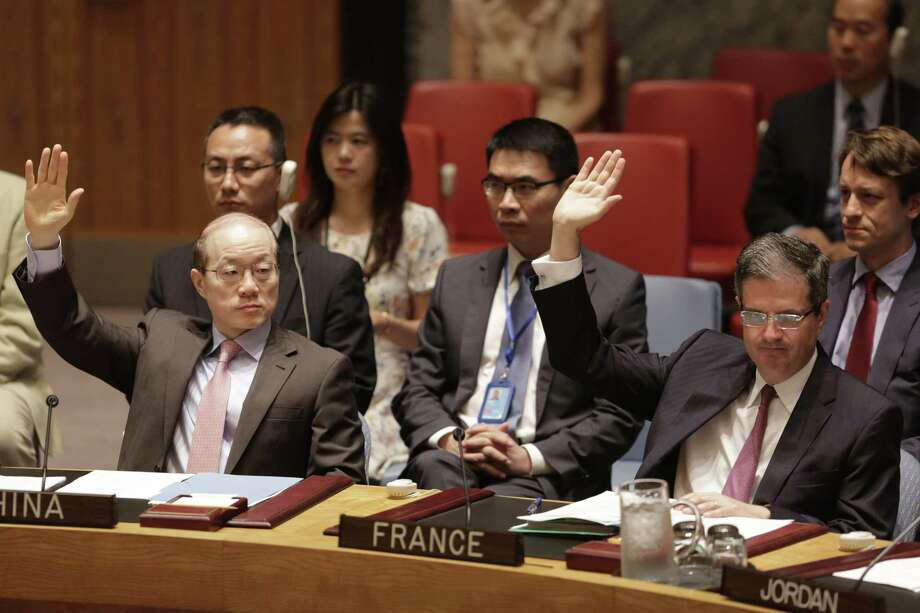 China's United Nations Ambassador Liu Jieyi, left, and French Ambassador Francois Delattre vote in favor of a Security Council resolution approving Iran's nuclear deal at United Nations headquarters on Monday, June 29, 2015. Photo: AP Photo/Mark Lennihan   / AP