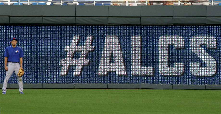 The Toronto Blue Jays' Munenori Kawasaki stands in the outfield during batting practice Thursday at Kauffman Stadium in Kansas City, Mo. Photo: Orlin Wagner — The Associated Press   / AP