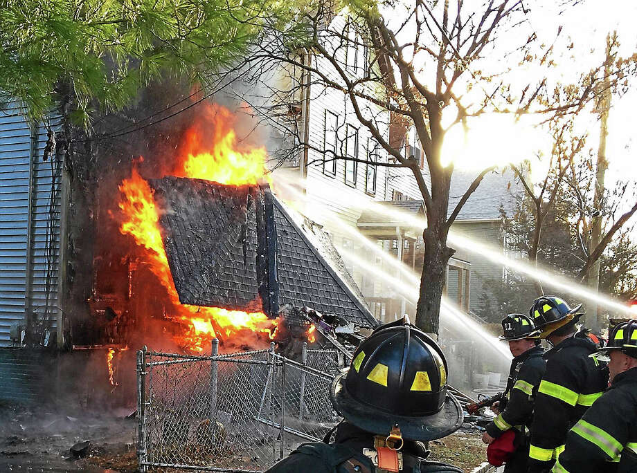 Rick Fontana photo  Fiirefighters in action at 55 Redfield St. Photo: Journal Register Co.