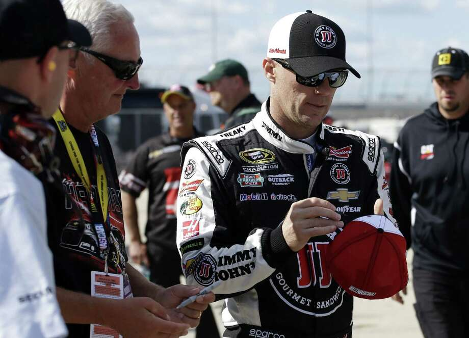 Kevin Harvick signs autographs for fans during practice on Saturday at Chicagoland Speedway. Photo: Nam Y. Huh — The Associated Press   / AP