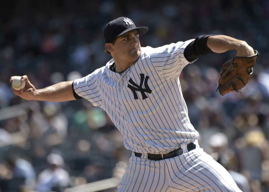 New York Yankees starter Nathan Eovaldi delivers the ball to a Tampa Bay Rays batter during a Sept. 5 game at Yankee Stadium. Photo: Bill Kostroun — The Associated Press File Photo   / FR51951 AP