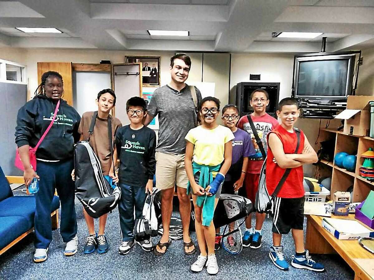 Fortney H. Stark, center, with students from Squash Haven.