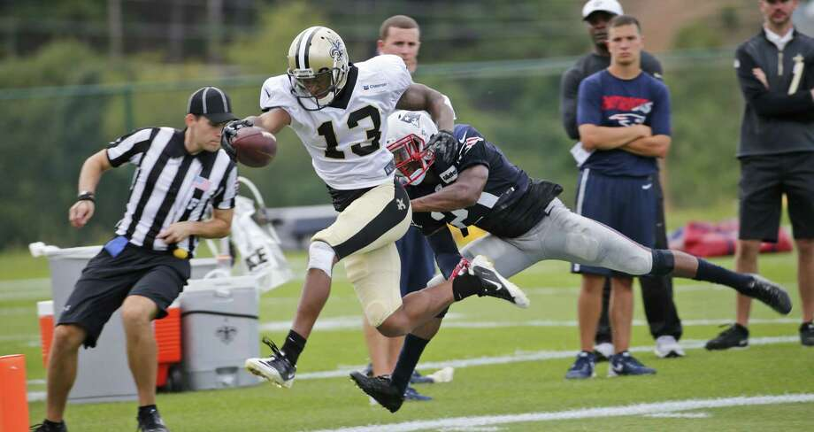 Saints wide receiver Joseph Morgan (13) stretches to the end zone as Patriots cornerback Malcolm Butler tries to make the stop during a joint practice in White Sulphur Springs, W.Va., on Wednesday. Photo: Steve Helber — The Associated Press   / AP