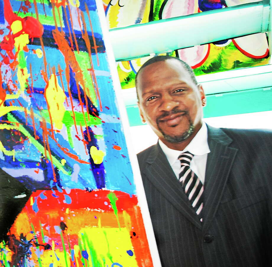 Hamden High School Principal Gary Highsmith in May 2014, next to a portion of a piece by senior Alicia Pascale in a student art show. Photo: Melanie Stengel — New Haven Register File Photo
