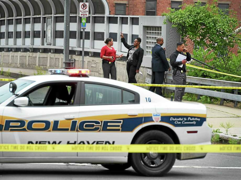 New Haven police investigate the discovery of human legs near the State Street railroad station in New Haven July 15. Photo: Peter Hvizdak — New Haven Register    / ©2015 Peter Hvizdak