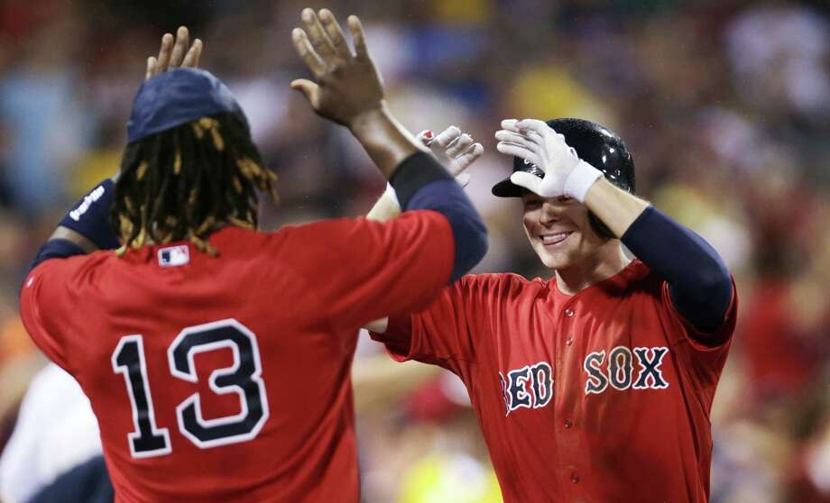 Boston Red Sox's Josh Rutledge, right, is congratulated by Hanley Ramirez after his two-run home run against the Kansas City Royals. Photo: Charles Krupa — The Associated Press   / AP