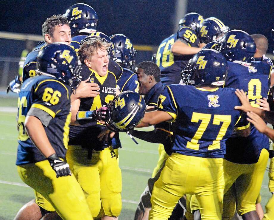 East Haven celebrates its 34-31 win in 4 overtimes against Hamden Friday night. Photo: Dave Phillips -- GameTimeCT