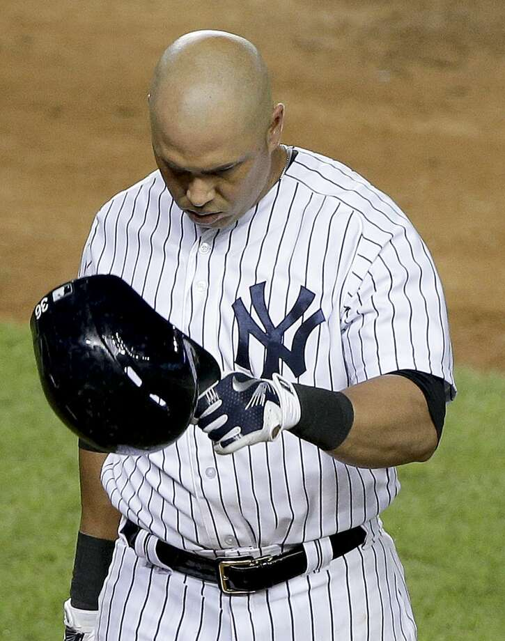 New York Yankees right fielder Carlos Beltran walks back to the dugout after striking out against the Cleveland Indians. Photo: Julie Jacobson  — The Associated Press   / AP