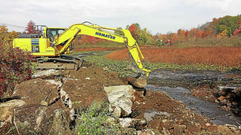 Connecticut Fund for the Environment Save the Sound began demolition of Pond Lily Dam Thursday to restore fish migratory patterns and reduce flood risk on West River. Photo: Journal Register Co.