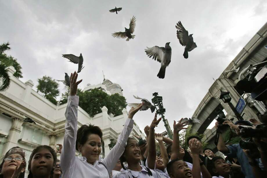 Doves are released for peace at the Erawan Shrine at Rajprasong intersection, the scene of Monday's bombing, in Bangkok, Thailand, Friday, Aug. 21, 2015. Somber horns sounded Friday at the site of Bangkok's deadly bomb blast as officials joined a multi-religious ceremony for victims of this week's attack, the latest effort to show that the bustling capital was respectfully, if cautiously, moving on.(AP Photo/Sakchai Lalit) Photo: AP / AP