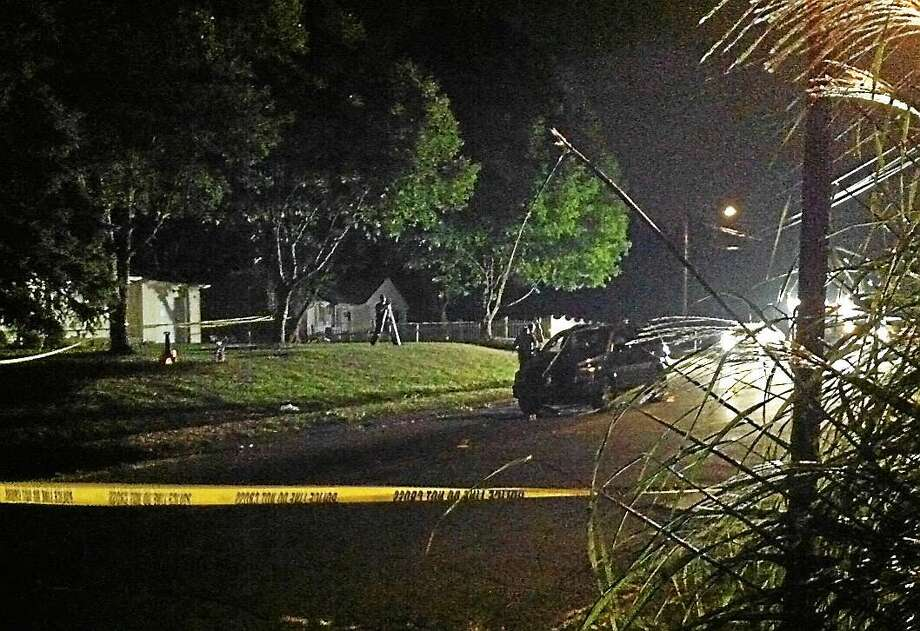 CONTRIBUTED PHOTO  Police were still on the scene late Thursday at Ford Street and Hughes Circle in Ansonia, where a 6-year-old girl was hit and killed by a car earlier in the evening. Photo: Journal Register Co.