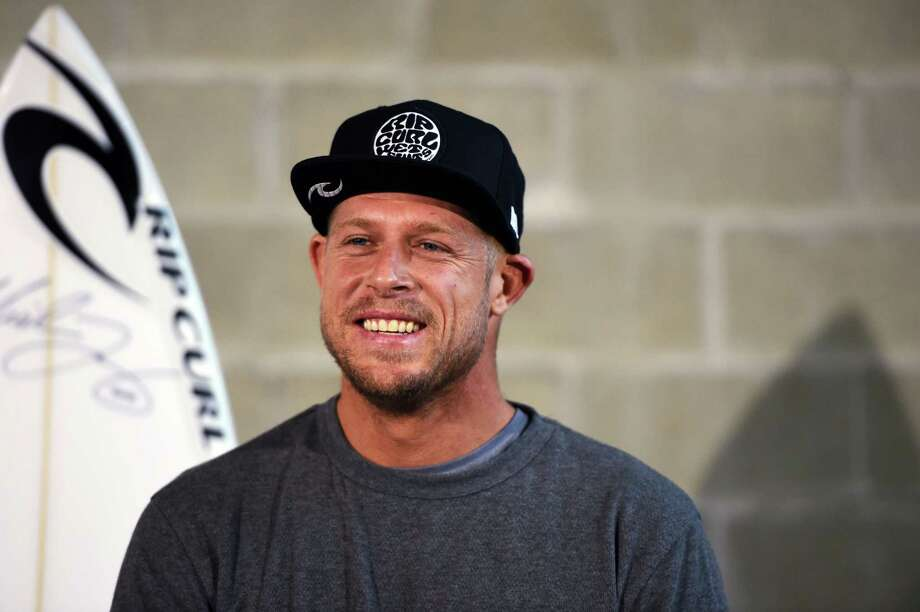 Australian surfing champion Mick Fanning smiles during a press conference on Tuesday in Sydney. Photo: Dean Lewins — The Associated Press   / AAP Image