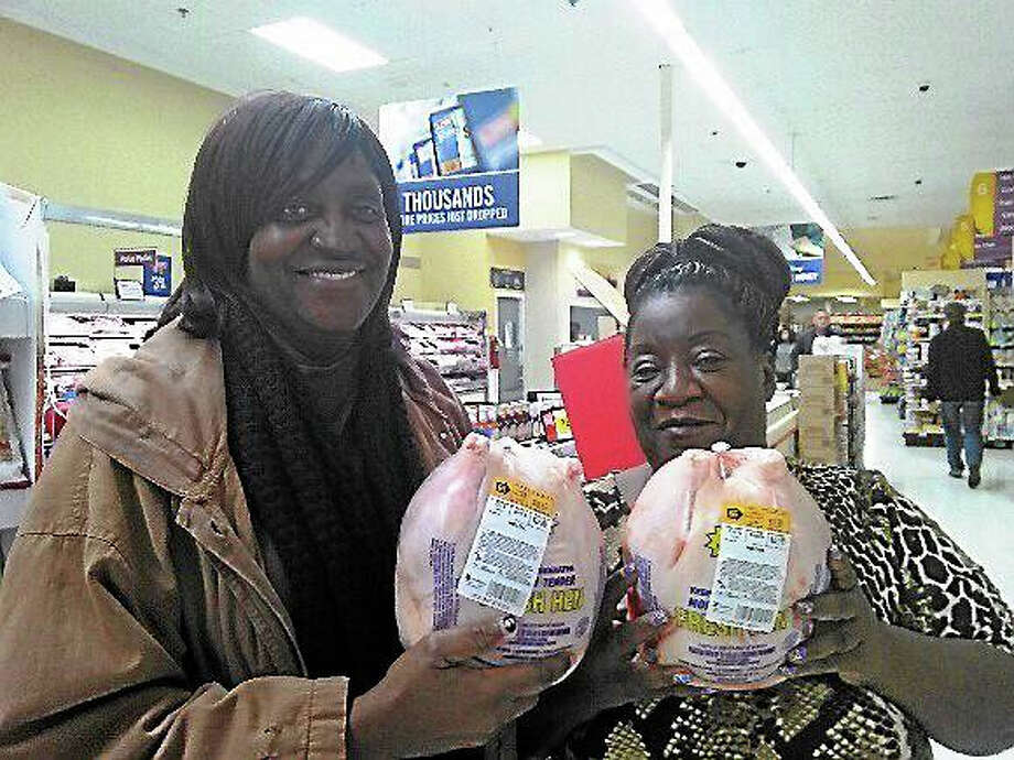 Minister Barbara Lawhorn, left, and Pastor Brenda Adkins, both of His Divine Will Fellowship Ministry, will include chicken in the church's Thanksgiving bags for those in need because the price of turkey is so high. Photo: Contributed Photo