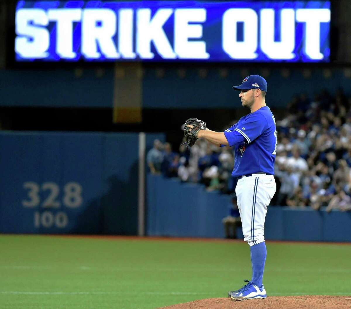 Toronto Blue Jays' starting pitcher Marco Estrada stands on the mound after striking out Kansas City Royals' Kendrys Morales during the eighth inning in Game 5 of baseball's American League Championship Series on Wednesday, Oct. 21, 2015, in Toronto. (Nathan Denette/The Canadian Press via AP) MANDATORY CREDIT