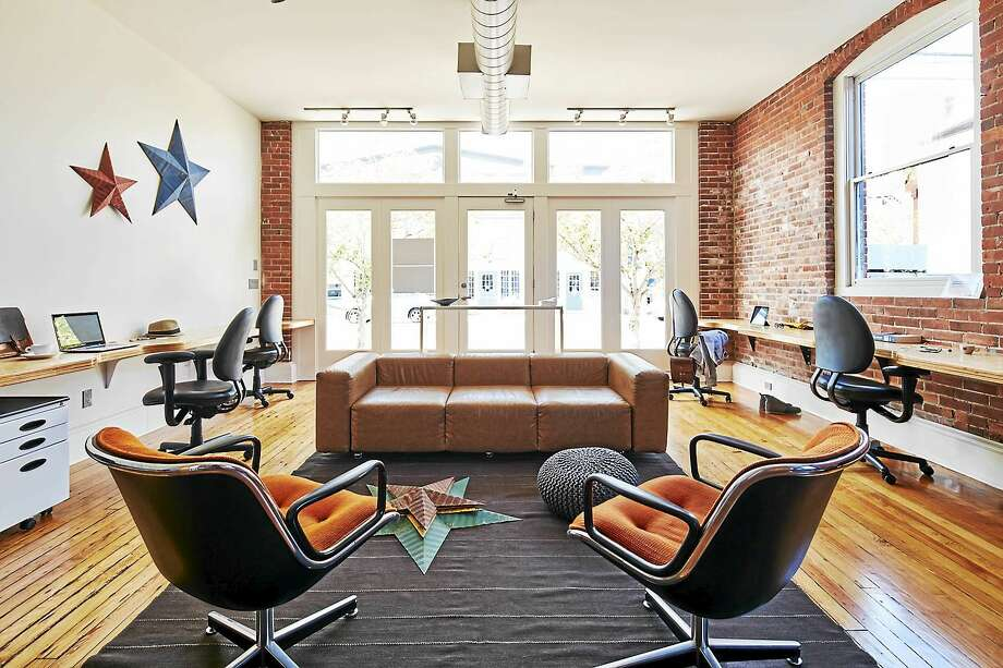 Guilford Coworking allows those who work from home to enjoy an office-like working space. Photo: Contributed Photo   / All rights reserved 2015