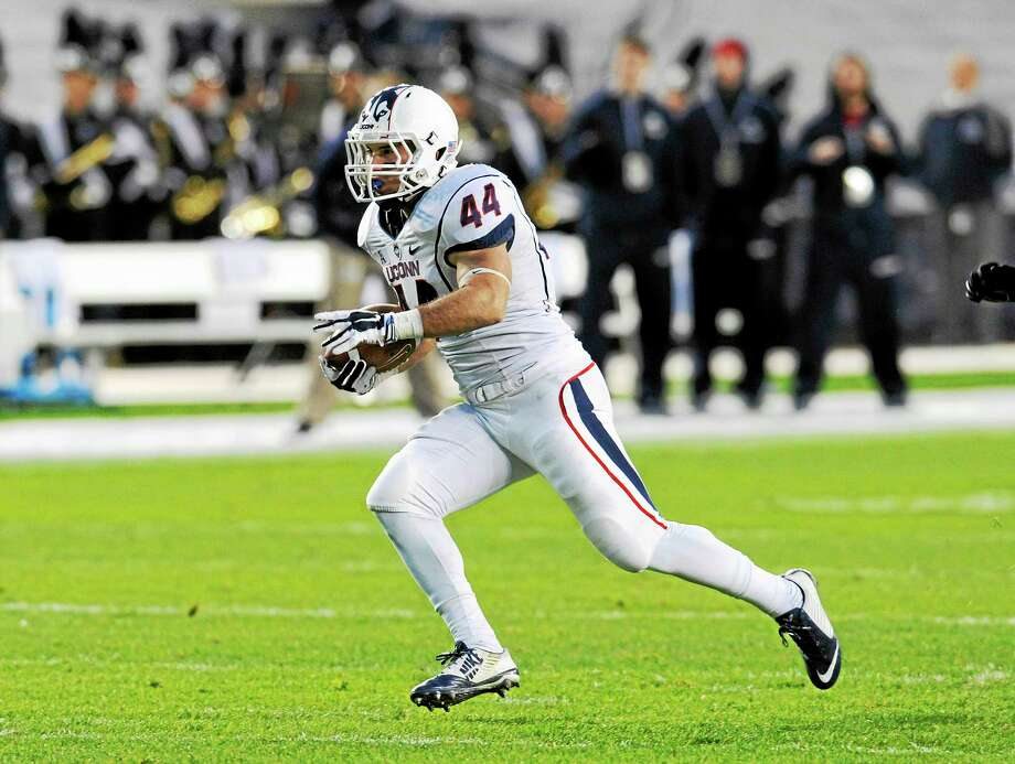 UConn running back Max DeLorenzo of Berlin has dealt with his share of turmoil since being recruited by Randy Edsall. Photo: Bill Kostroun — The Associated Press File Photo   / FR51951 AP