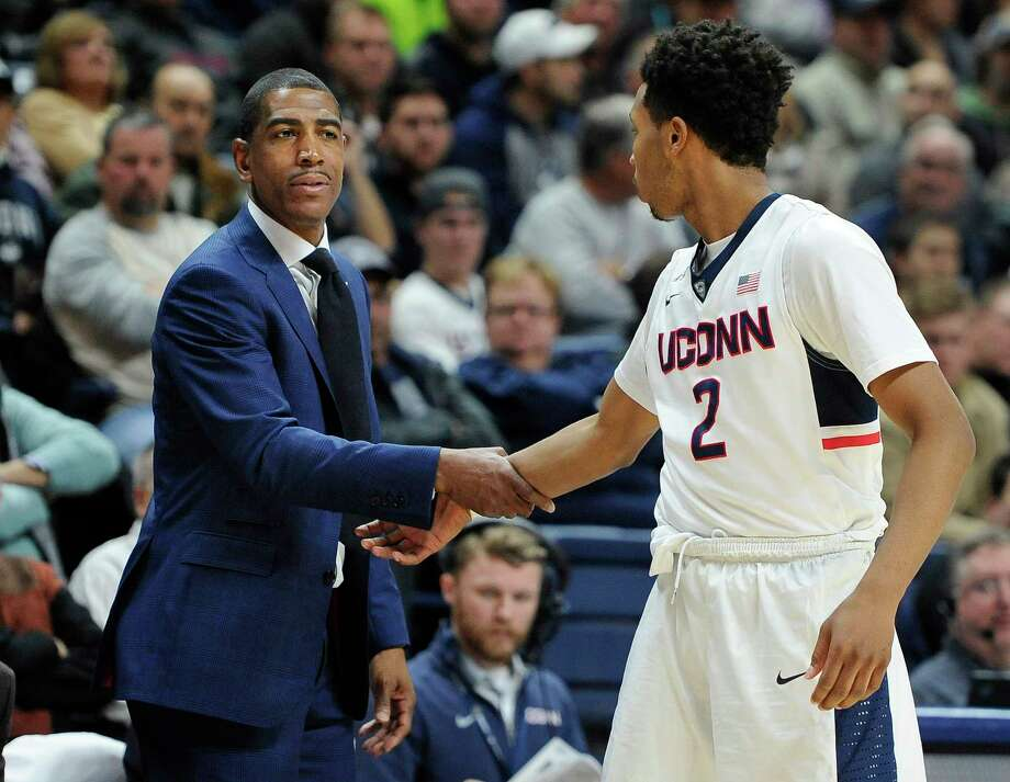 UConn coach Kevin Ollie talks with Jalen Adams, right, in the first half of Tuesday's game against New Hampshire. Photo: Jessica Hill  — The Associated Press   / FR125654 AP