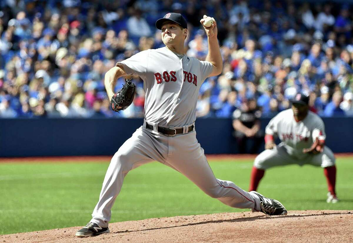 Red Sox starting pitcher Rich Hill works against the Blue Jays in the first inning on Sunday.